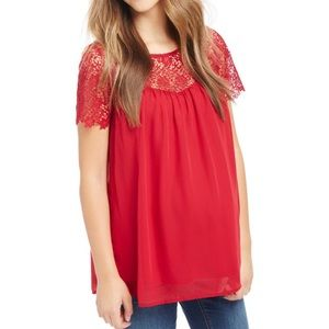 Red maternity top with lace detail